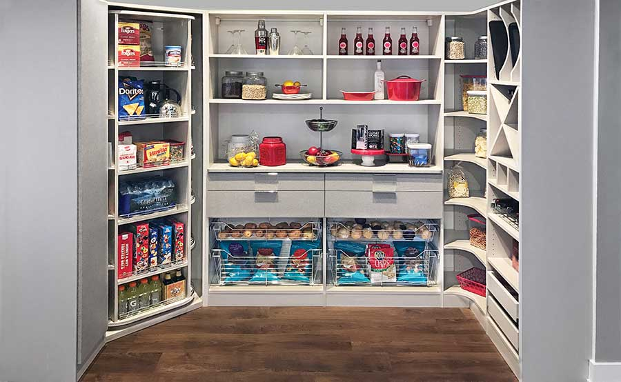 walk in pantry with rotating closet corner unit