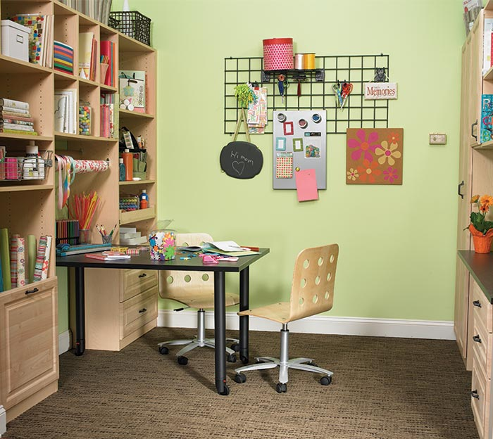Craft room with custom wall unit storage system for a scrapbooker