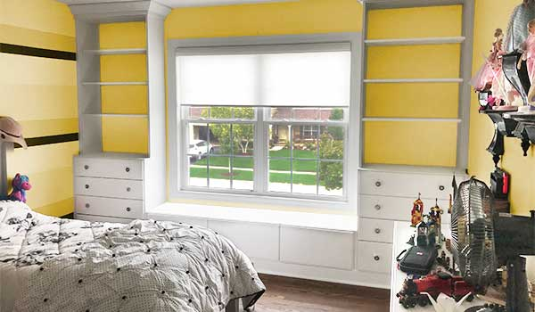 yellow and gray bedroom with built-ins