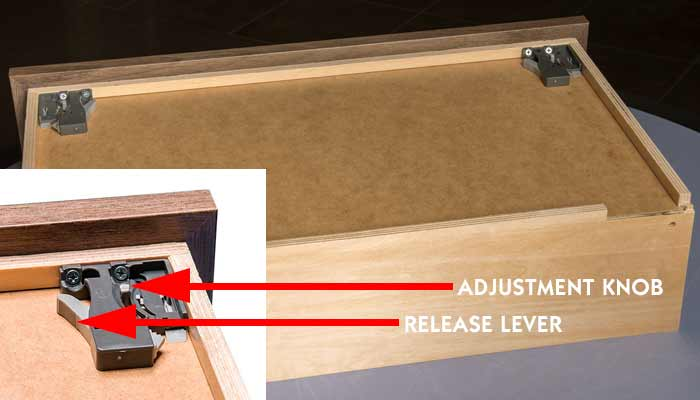 Location of release lever and adjustment knob for an undermount drawer.