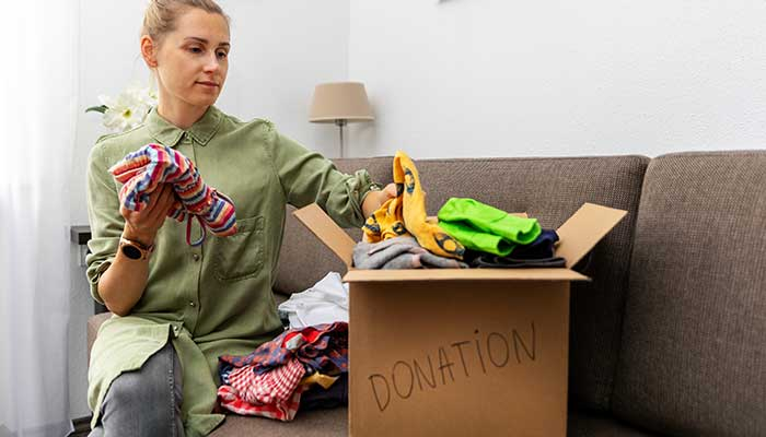 Donate old clothes as part of closet cleaning tips