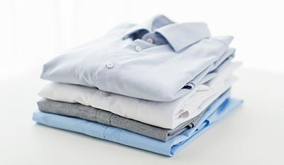 How to fold sweaters and shirts for stacking on closet shelves