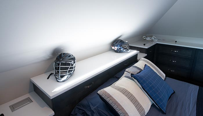 integrated lighting system in custom bed headboard with storage