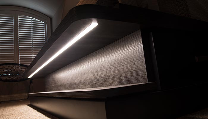 LED strip lighting integrated into footboard