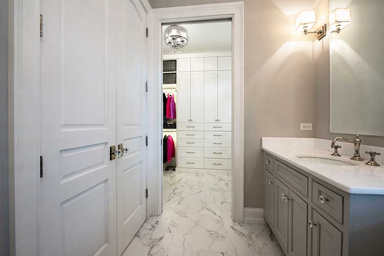 bathroom with walk in closet