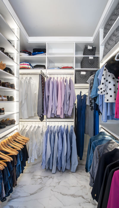 Custom closet organized for two people