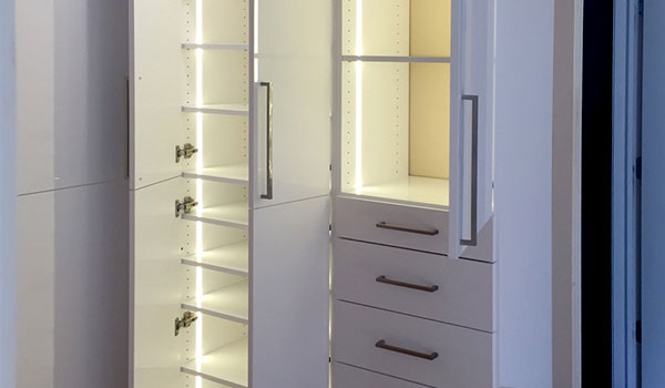 Custom wardrobe style closet system with closet lighting