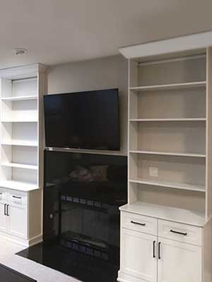fireplace bookshelves and integrated toy bench for child