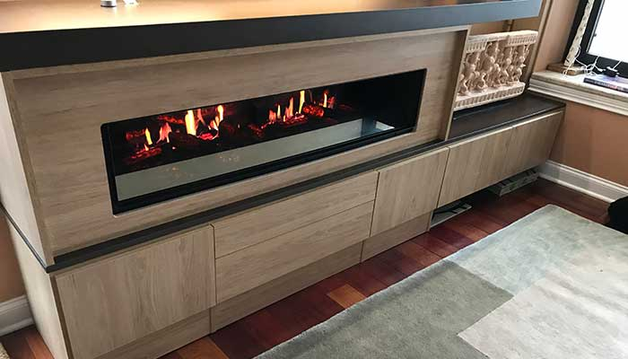 Close-up of the asymmetrical modern fireplace surround for an electric fireplace