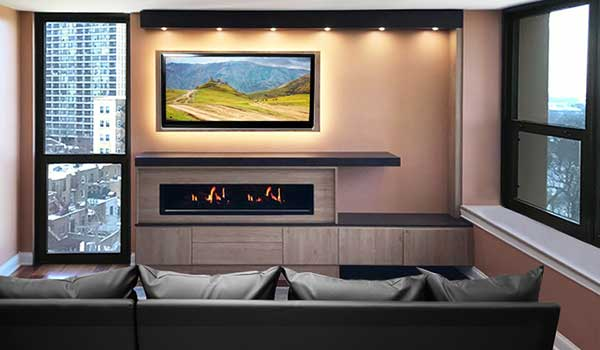 Modern home entertainment center with fireplace surround and lighting