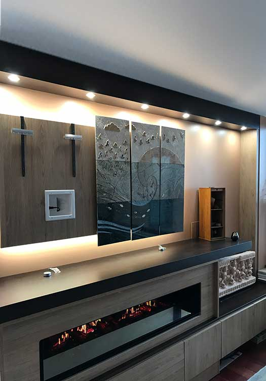 This modern wall unit serves as both entertainment center and fireplace surround