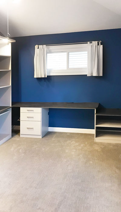 Wire management uses a custom home office cabinet under desk as wire covers