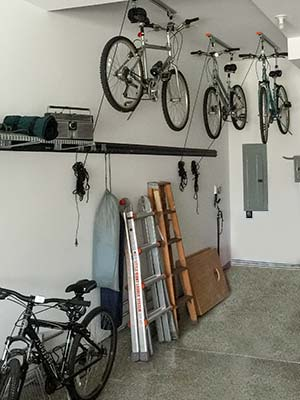 bike hoist stores bicycles on the ceiling of garage