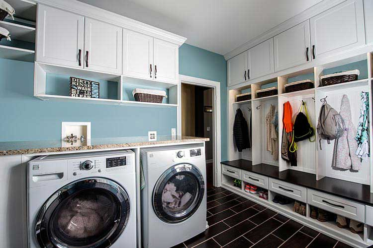 Custom storage solutions with laundry room cabinet and mud room organization system