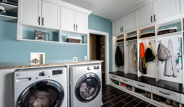 Custom design for combination laundry room and mudroom for busy family entrance