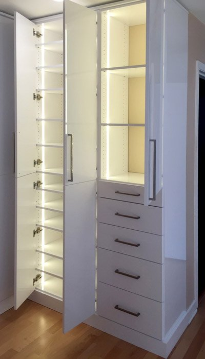 Wardrobe closet with LED vertical strip lighting around shelves