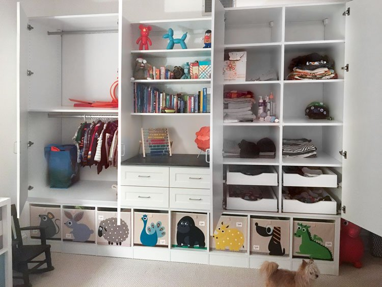 Custom multiuse closet wall unit and storage cabinets for a child's bedroom