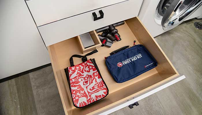 bottom drawer of laundry room storage with custom cutout