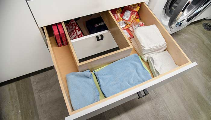 middle drawer of laundry room storage with custom cutout