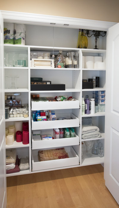Custom bathroom shelving for linen and toiletries.