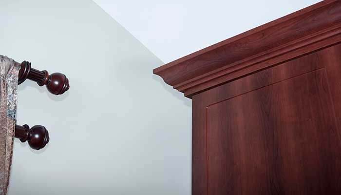 crown moulding and slanted ceiling