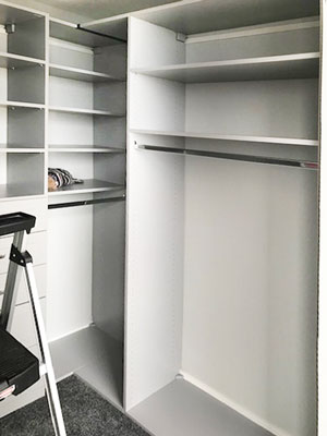 rain cloud closet with corner shelving and hanging