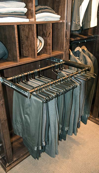 Master closets with pull-out pant rack custom closet accessory