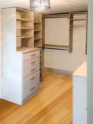 Master closet design with shelves, drawers and laundry basket