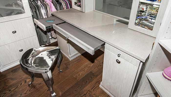 Built-in closet vanity with pull-out velvet countertop extenders