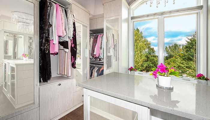 Closet dressing room with mirrored cabinets