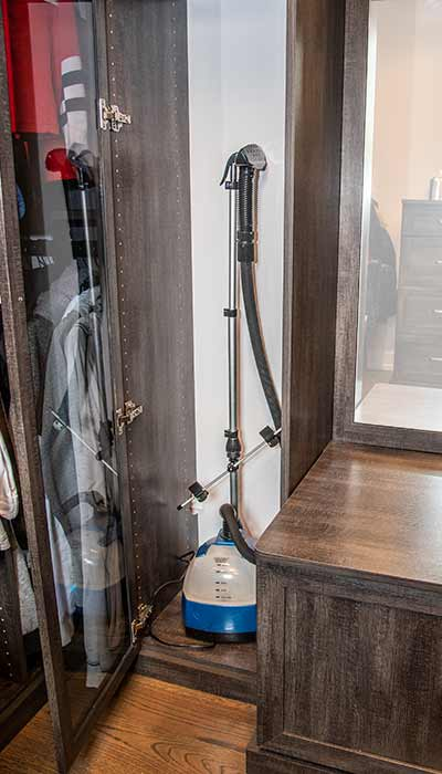 Closet steamer and includes a power outlet for charging the unit.