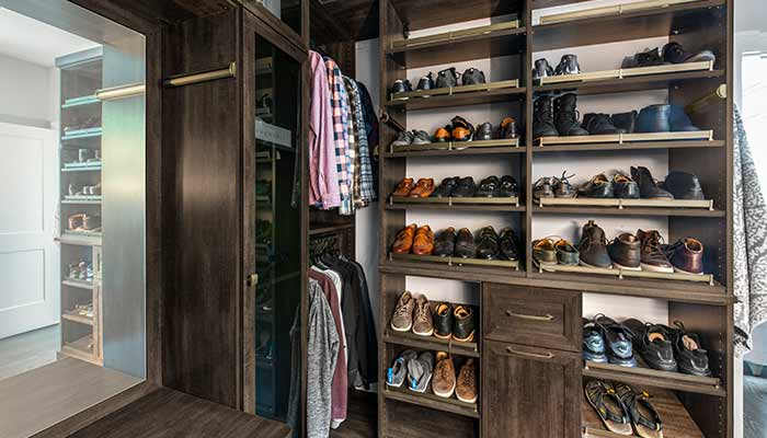 Shoe storage wall for a mans closet