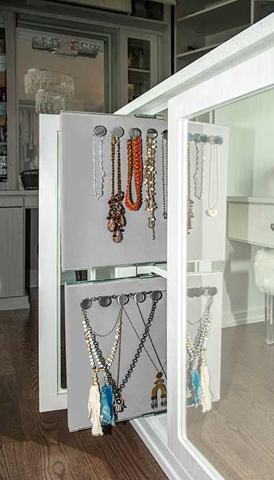 Built-in closet jewelry organizer for necklaces that slides in and out