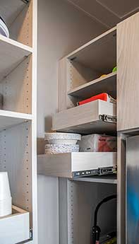 Pull-out pantry shelves provide access to items stored in the back.