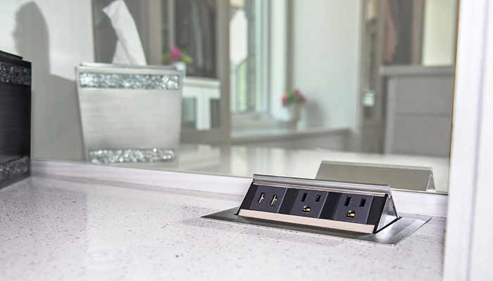 Pop-up USB charging station and electrical outlets built into vanity countertop