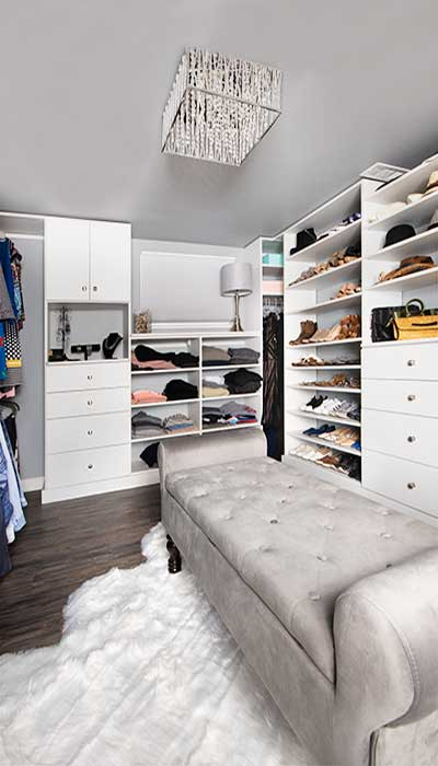 Basement of small home with fancy closet for storage of large wardrobe