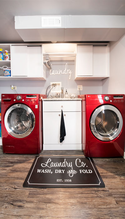 Laundry room with storage above washer and dryer