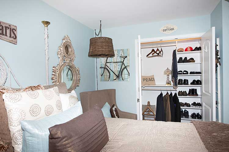 Small guest bedroom closet with organized storage