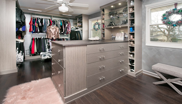 view of her side of master walk in open closet