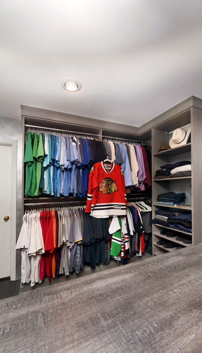 view of his side of master open closet