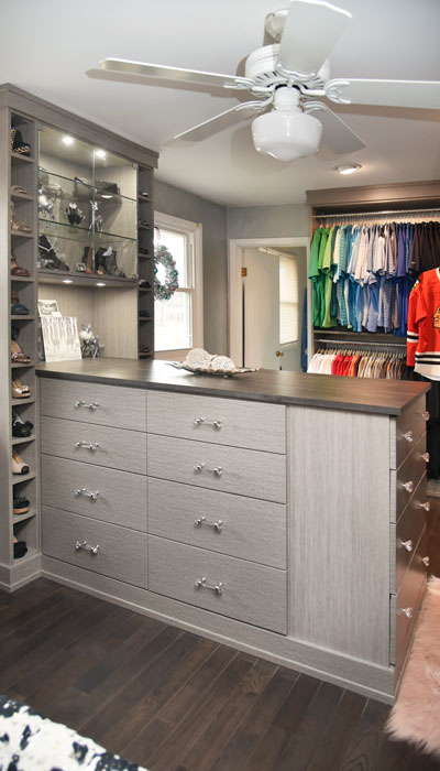 custom closet island in haze laminate with vintage countertop
