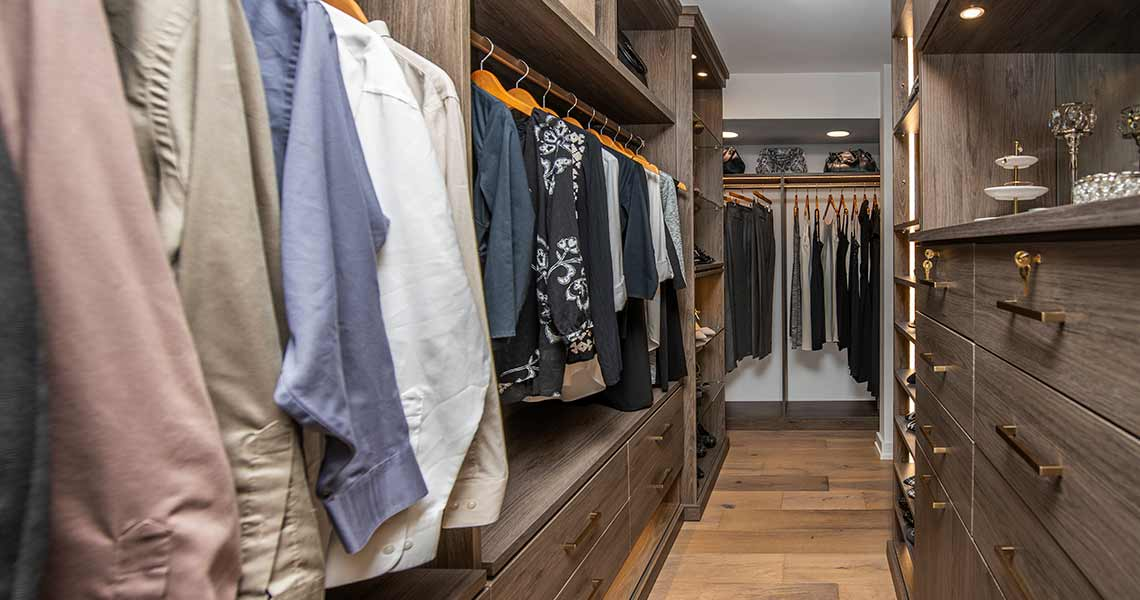 Galley style walk through closet that combines efficiency with elegance