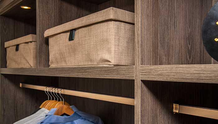 Decorative storage boxes on closet shelves