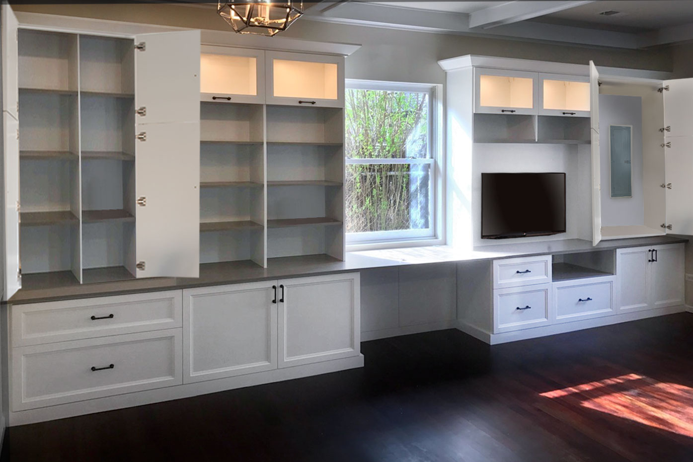 Large built-in entertainment center with built-in desk and extra storage