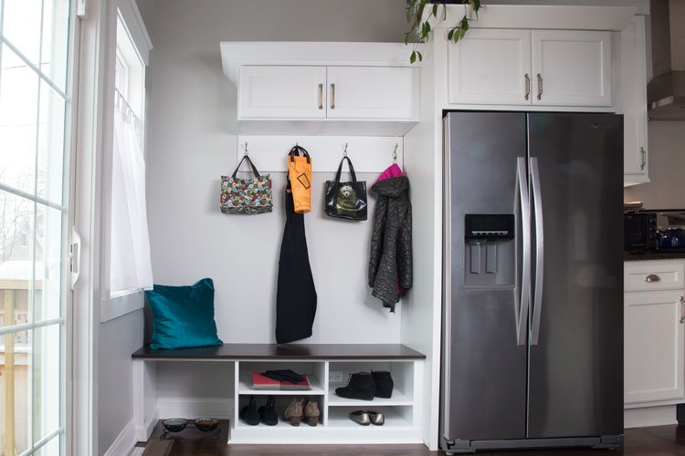 sunroom transformed into mudroom organization system