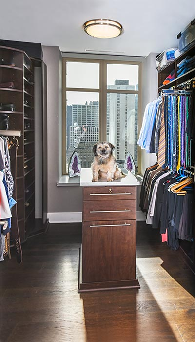 Small walk-in closet that's big on ammenities