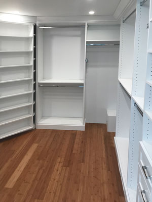 custom walk in closet with pipe cover