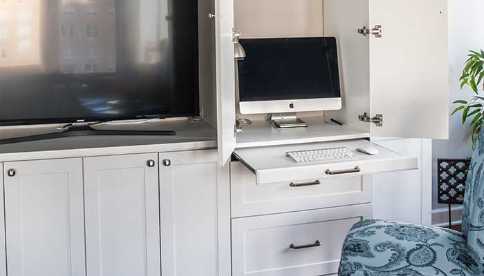 Pull-out desk adds functionality to entertainment center