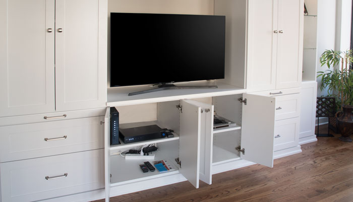 cabinets below offer storage for electronics and wires