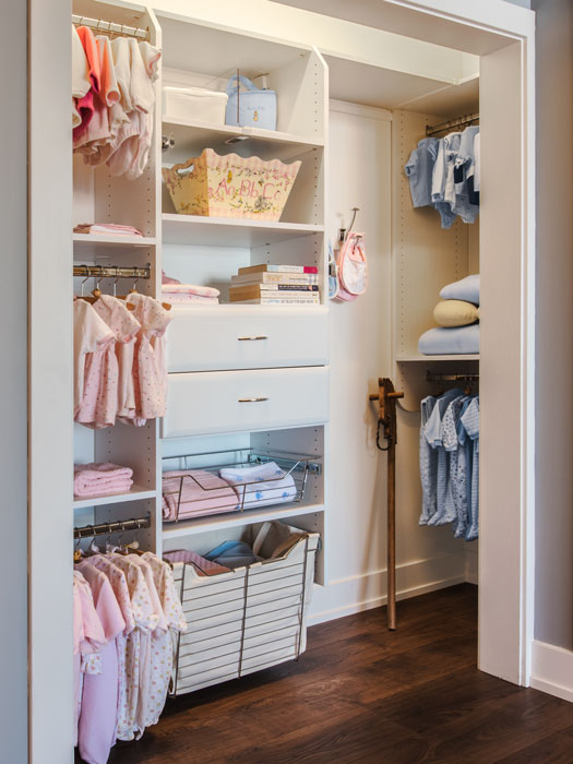 Baby closet with hooks, pull-out baskets, and built-in hamper